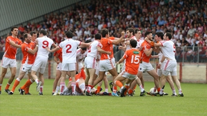 The Tyrone and Cavan players get into a scuffle during their qualifier