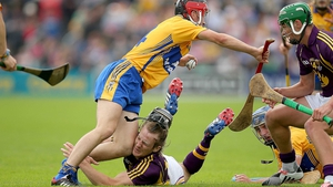 Crash: Wexford's Liam Og McGovern loses his helmet in a collision with Jack Browne of Clare