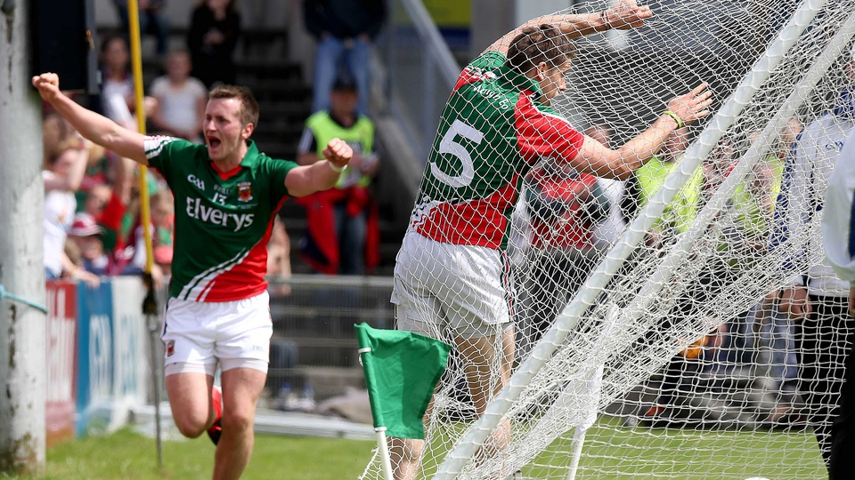 Mayo's Lee Keegan hits the back of the net after scoring a goal as Cillian O'Connor celebrates setting him up