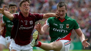 Donal O'Neill of Galway with Cillian O'Connor of Mayo battle for the ball
