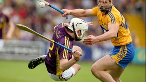 Bang: Liam Ryan of Wexford with John Conlon of Clare