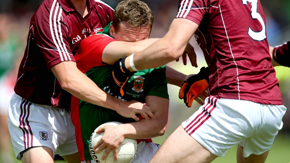 Mayo's Andy Moran under pressure from Galway players