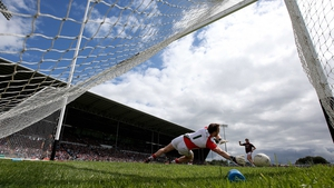 Mayo goalkeeper Robbie Hennelly saves a penalty from Shane Walsh of Galway