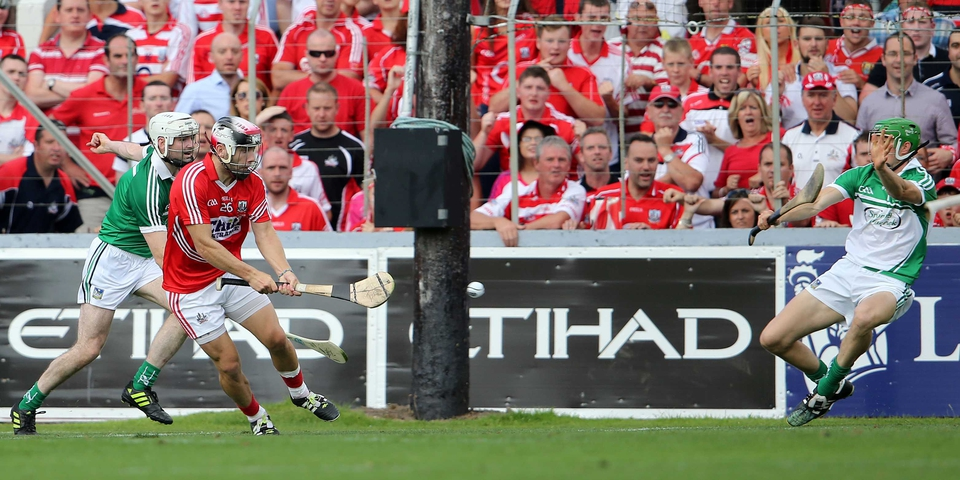 Paudie O'Sullivan scores a goal past Limerick goalkpeeper Nickie Quaid