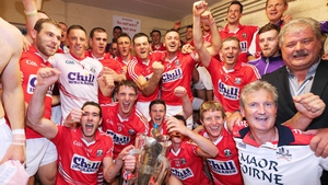 The Cork team celebrate with the Munster SHC trophy