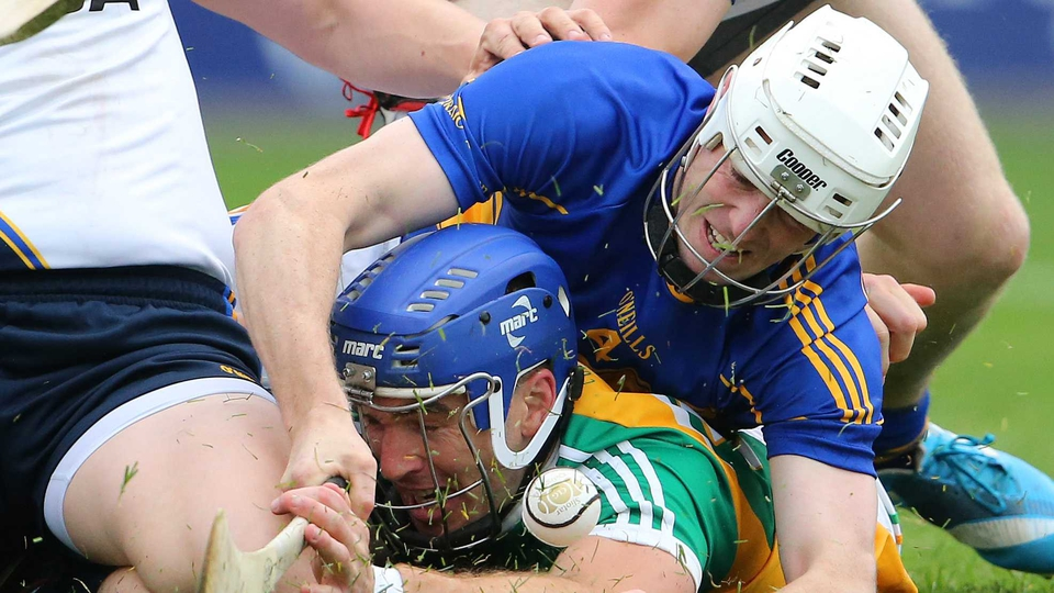 Offaly's Brian Carroll is tackled by Michael Cahill of Tipperary