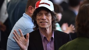 And Mick Jagger enjoyed the atmosphere in Rio, wearing a hat that couldn't possibly cause any more 'jinxing' harm