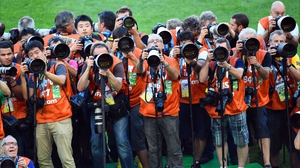 A horde of professional photographers swelled as the minutes until the match winded down