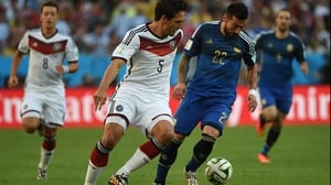 The match started off with a quick pace that only let up when the half-time whistle sounded. Germany defender Mats Hummels worked against Argentina forward Ezequiel Lavezzi