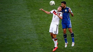 While Germany forward Miroslav Klose vied with Argentina defender Ezequiel Garay on the other end