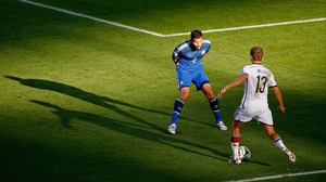 Germany's veteran forward and goal machine Thomas Mueller looked to break away from Garay in a spot of sunlight
