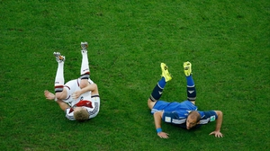 The second half got off to a bit of a stop start, with Argentina earning two yellow cards in two minutes at 65'. Here, Germany forward Andre Schuerrle and Argentina defender Pablo Zabaleta lie on the ground after a clash