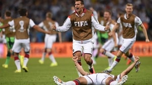 Klose and the rest of the German squad briefly stormed the field in their elation