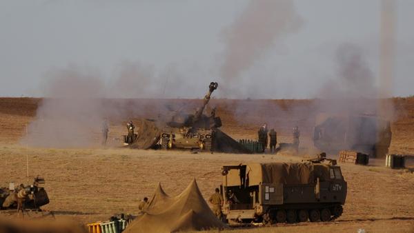 An Israeli unit fires towards targets in Gaza