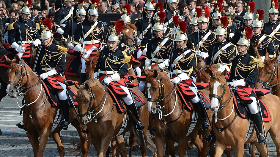 Republican Guards parade on the Champs-Elysees during the annual Bastille Day military parade