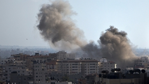Smoke billows from a building hit by an Israeli air strike in Gaza City