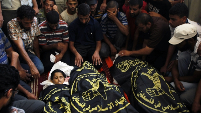 Palestinian mourners surround the bodies of four-year-old Palestinian girl Sarah Sheik al-Eid and of her father and uncle, during their funeral in Rafah
