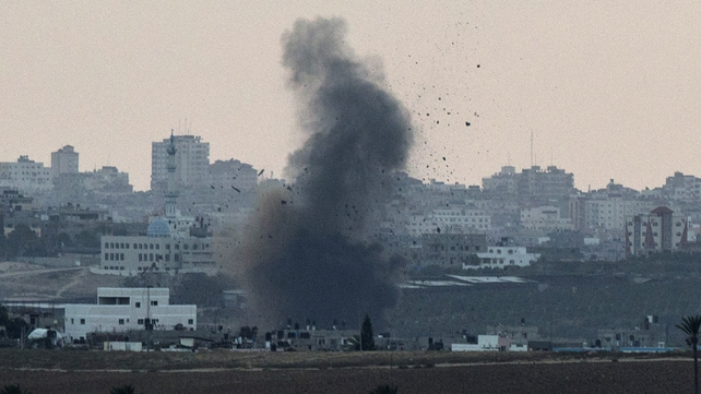 Smoke is seen billowing from Gaza following an Israeli air yesterday