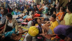 Evacuees take refuge in a basketball court turn in Manila