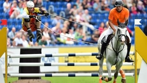 Members of the Swiss group Offroad-Kjoring jump a hurdle during the horse show tournament CHIO in Aachen, Germany