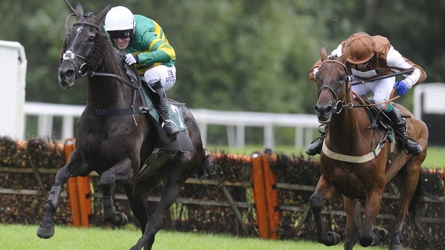 Tony McCoy riding On The Record (left) clears the last to win The 32Red On The App Store Handicap Hurdle