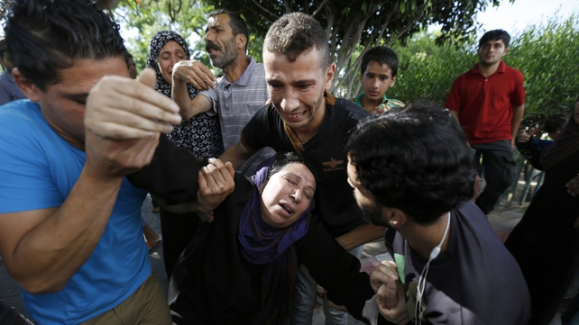 Relatives react to news that the four young cousins had been killed on a beach in Gaza