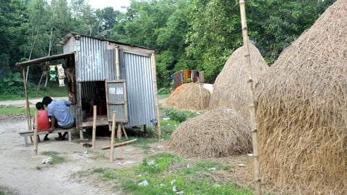 Images from Gaibandha: a roadside shop beside some haystacks