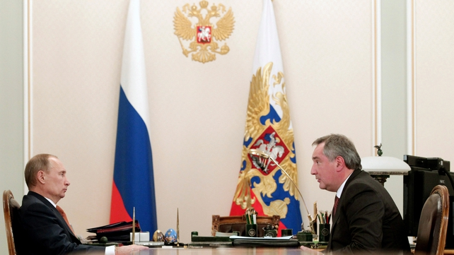 Vladimir Putin (left) and Dmitry Rogozin have spoken out against the US move