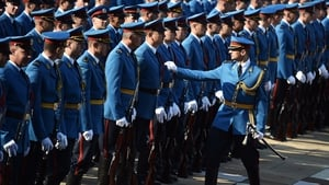 An officer of the Serbian honor guard inspects a soldier's uniform prior to the arrival of the Serbian Prime Minister and his Romanian counterpart at an event in Belgrade
