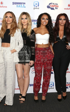 "Little Mix have hit out at Heat magazine in the UK for quoting a source who claims that Perrie Edwards is feeling ""pushed out of the group""."