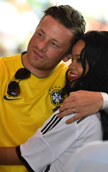 Jamie Oliver and Rihanna take a selfie at the 2014 FIFA World Cup Final in Brazil.