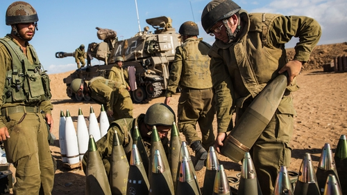 Israeli soldiers near Sderot organise artillery shells for firing into Gaza