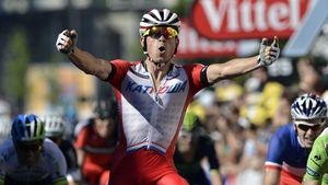Alexander Kristoff celebrates as he crosses the finish line