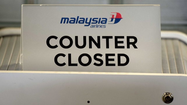 A closed Malaysia Airlines counter at Schiphol airport