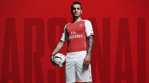 New boy Mathieu Debuchy models the Gunners' kit