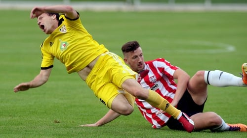 Siarhei Balanovich is tackled by Derry's Shane McEleney