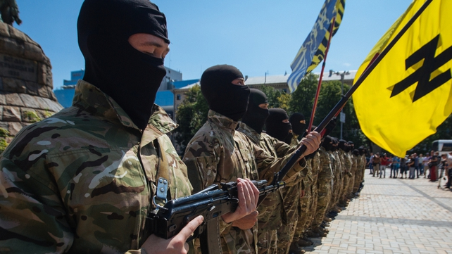 New soldiers of Ukrainian army battalion 'Azov' attend their oath of allegiance ceremony before departing to eastern Ukraine