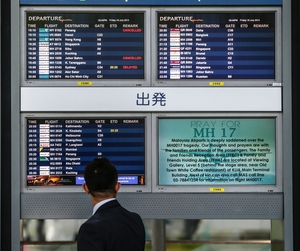 'Pray for MH17' is seen on a screen at Kuala Lumpur International Airport