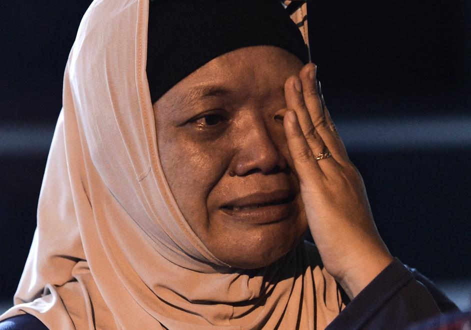 A relative of a crew member in tears in Kuala Lumpur, Malaysia