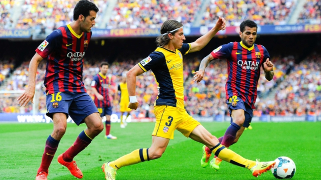 Filipe Luis in action against Barcelona last season