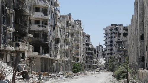 Destroyed buildings are seen in the Homs neighbourhood of Khaldiyeh, formerly held by rebel fighters and captured by Syrian government forces