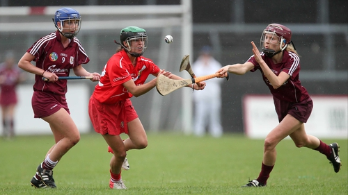 Cork's Julia White with Niamh Kilkenny and Aislinn Connolly of Galway