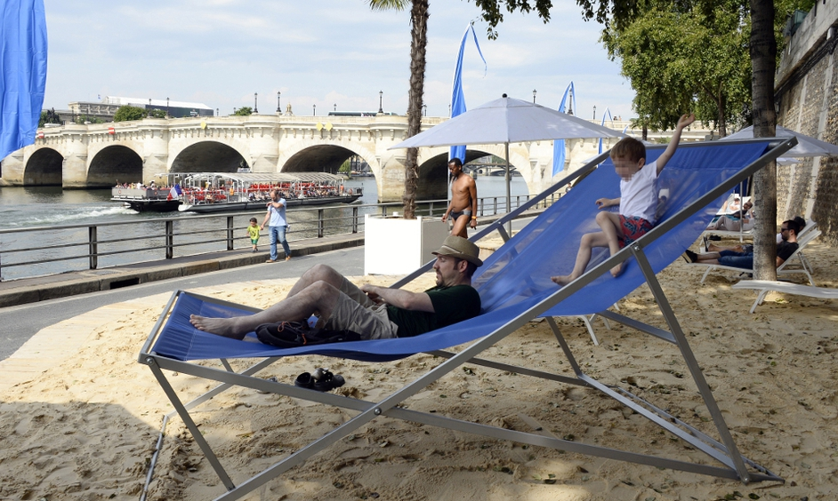Opening day of the 13th edition of Paris-Plages as artificial beach built on banks of Seine