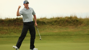 Rory McIlroy celebrates a birdie putt on the 14th green during the third round