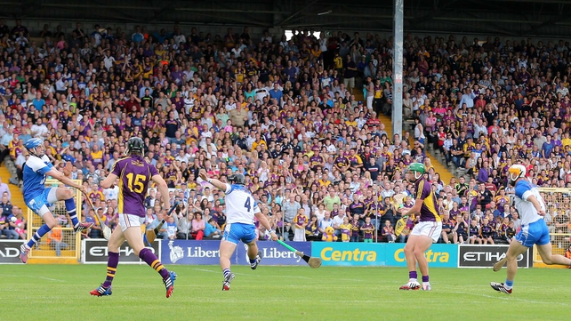 Conor McDonald beats Stephen O'Keeffe for a Wexford goal