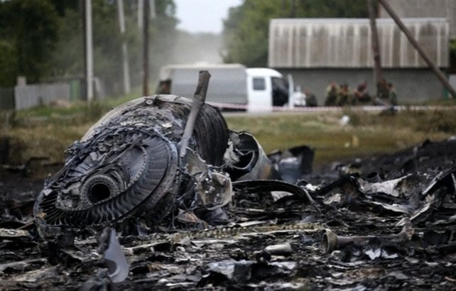 Ukrainian authorities and Russian-backed separatists have accused each other of bringing down the plane