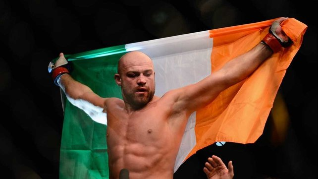 Cathal Pendred holds aloft the tri-colour after victory