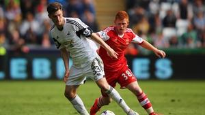 Ben Davies (left) in action for Swansea City