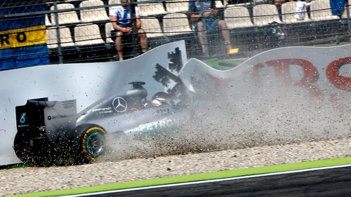 Lewis Hamilton crashes into the hoardings at Hockenheim