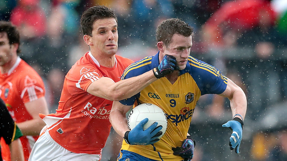Quite a cheeky tackle on Roscommon's Kevin Higgins by Stephen Harold of Armagh